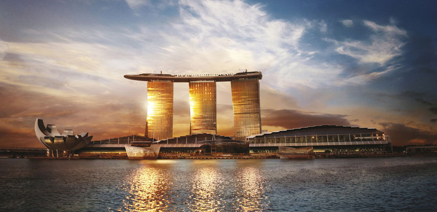 The distinctive, triple-towered Marina Bay Sands in Singapore features SkyPark, a rooftop venue the size of three football fields. Credit: Marina Bay Sands