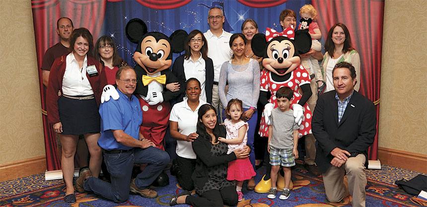 "The California Transit Association's Public and Community Transportation Conference & Expo featured a Disneyland-inspired theme: ""Imagineering Transit."" Attendees and their families posed for photos with Mickey and Minnie. Credit: Tom Kawashima"