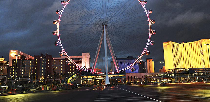 The 550-foot High Roller has 28 cabins that each hold up to 40 attendees. The world's largest observation wheel towers over The Linq — Caesars Entertainment's new open-air retail, dining and entertainment venue. Credit: The Las Vegas News Bureau In this photo provided by the Las Vegas News Bureau, the High Roller officially lights up the Las Vegas Strip. The world's tallest observation wheel is the focal point of The LINQ, Caesars Entertainment's $550 million outdoor retail, dining and entertainment district. Friday, February 28, 2014. (Photo/Las Vegas News Bureau, Darrin Bush)