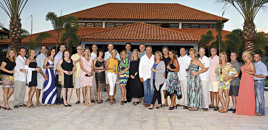 Enjoying the Matrix Communications Inc. reception at Sandals LaSource Grenada are (l to r) Karie Timion, Mark and Jocelyn Hechtl, John and Carolyn Mirviss, Brian and Lisa Finnvik, Craig and Suzanne Nordstrom, Dan Galbraith, Mary Jo McGowan, Charlie and Lori Eicher, Ann and Tom Pearson, Tammy Peterson and Jim Peterson, Steve and Kareen Ferry, Mike and Paulette Parrott, Frank Millo, Susan and Kevin Peters, Peter McAllister, Lori Robbins, Mike Ellis, Shannon and Jason Cardwell. Credit: Matrix Communications Inc.