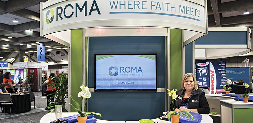 RCMA board member Debbie Mardis greets attendees in the Welcome Booth at the RCMA Emerge 2014 Conference held in Sacramento, California. Credits: RCMA