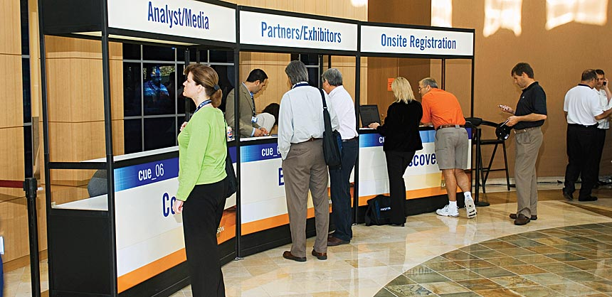 Separate registration counters for different attendee types keeps the registration process moving in a fluid manner.