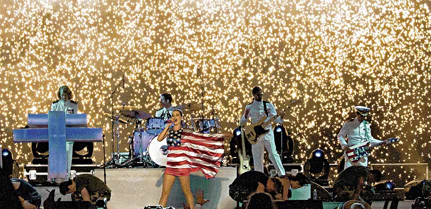 Bay Fireworks, which specializes in special effects displays for events, produced this fireworks waterfall backdrop to a high-octane Katy Perry performance for veterans.