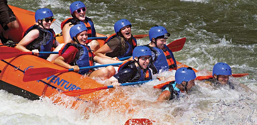 Working as a team, rafters navigate the rapids in New River Gorge in West Virginia. Credit: Adventures on the Gorge