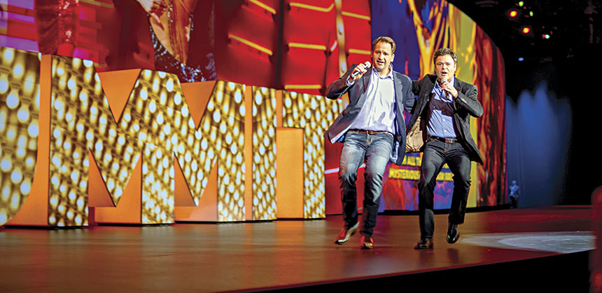 Donny Osmond (r) kicked off the Adobe Summit with song and dance along with John Mellor, Adobe V.P., Strategy, Business Development and Marketing.