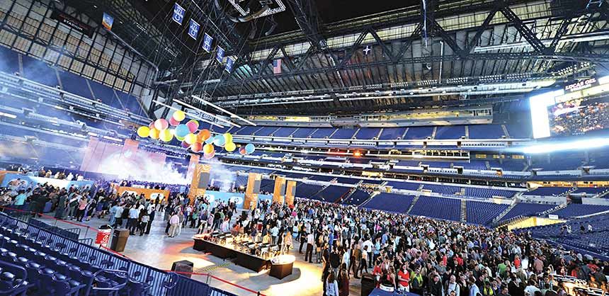 A corporate group event on the field at Lucas Oil Stadium, home of the NFL's Indianapolis Colts. Credit: Visit Indy