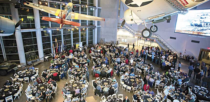 The attendees of the Technology Exchange enjoyed dinner in the National WWII Museum's Freedom Pavilion and a performance by the Victory Belles. Credits: Mark McDonald Photography