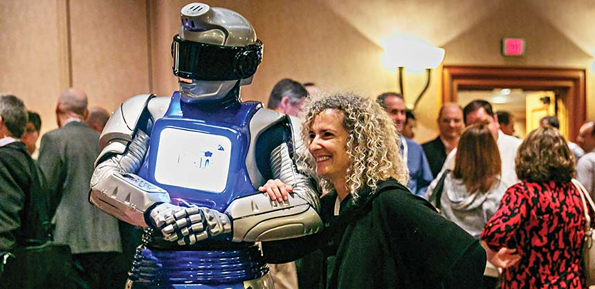 An IBM conference attendee experiences the cognitive computing power of a Watson-powered robot. Credit: IBM