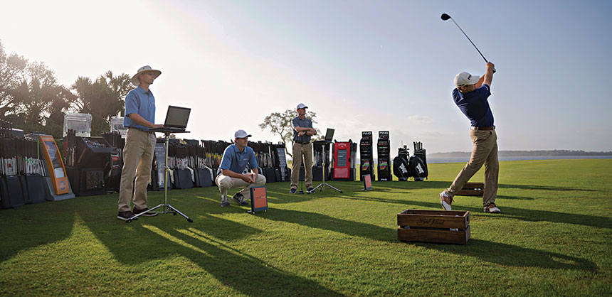 Sea Island Resort Golf Performance Center Manager Craig Allan (second from right) coaches a club-fitting session.