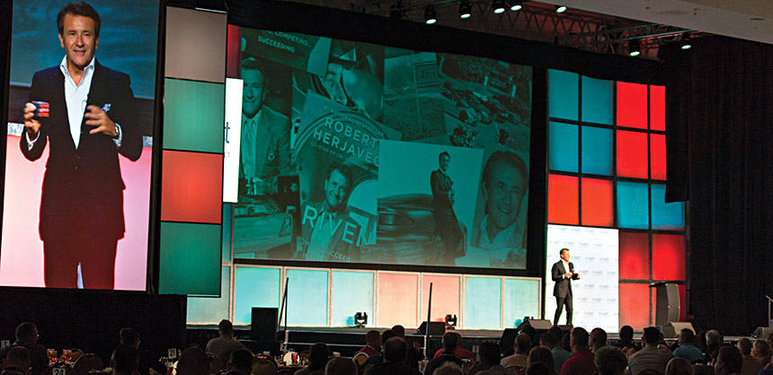 "The wide-format collection of screens creates a dynamic experience with Robert Herjavec, from TV's ""Shark Tank,"" at the in.Sight 2017 conference. Credit metroConnections"