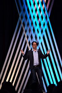 National Geographic Traveler's Digital Nomad Robert Reid gave the Keynote Address during Visit Seattle's 2018 Annual Meeting. Credit: Alan Alabastro of Alabastro Photography