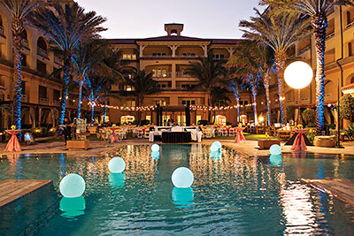An evening's event by the pool at Eau Palm Beach Resort & Spa.