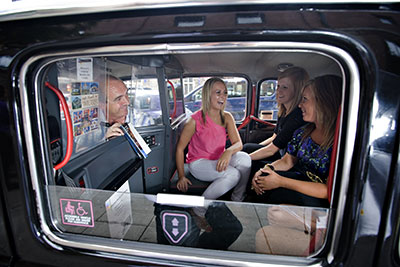 A must-do for visitors to Northern Ireland is Belfast Black Taxi's historical mural tour. Credit: Tourism Northern Ireland