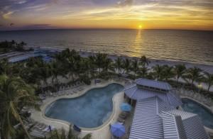Aerial View --- Beachside Pool Complex and Beach (Orange Sunset) --- The Naples Beach Hotel & Golf Club