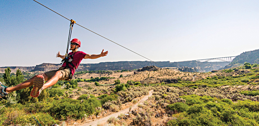 A rider enjoys the zip line at Twin Falls in South Central Idaho.