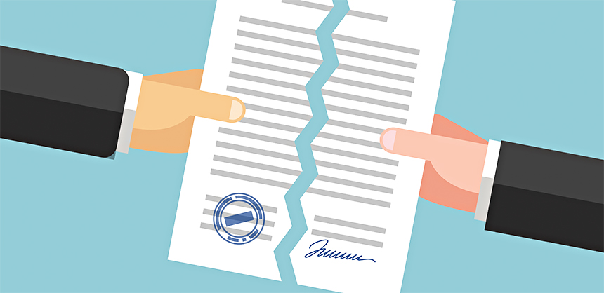Two hands are tearing up a signed paper. Cancellation of contract, document or agreement. Business concept