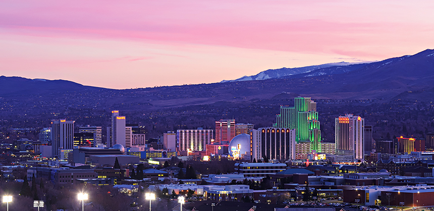 RENO, NEVADA, UNITED STATES - Jan 22, 2020: Reno, Nevada - January 2020: A colorful sunset over downtown Reno, Nevada and its downtown casino towers.