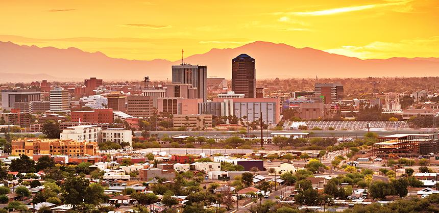 Tucson, Arizona, USA downtown city skyline with mountains at twilight.