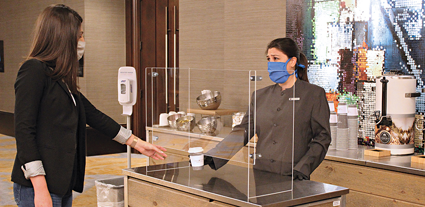 Omni Hotels & Resorts has updated the check-in process, meeting room layouts, and food and beverage services — including using Plexiglas dividers when serving attendees — for a safer experience at the company's hotels. Courtesy of Andrew Rubinacci